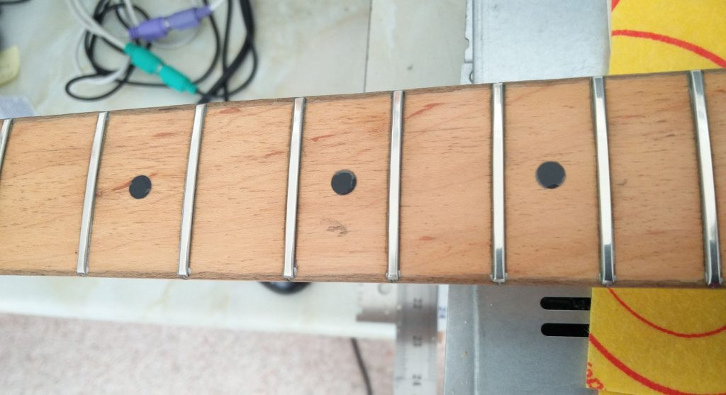 Smooth and level frets at last
